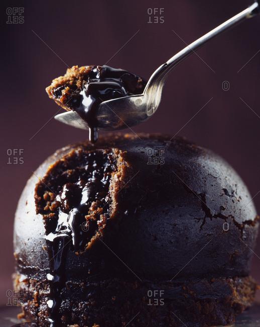 Chocolate pudding oozing chocolate sauce