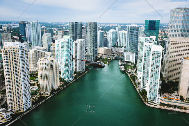 Skyscrapers and helicopter above Miami River, Brickell, Downtown Miami, Florida, USA