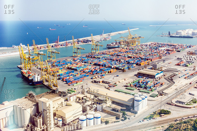 Elevated view of port cranes and cargo containers at sea port, Barcelona, Spain