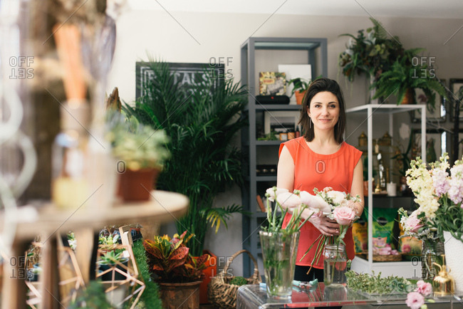 Portrait of florist arranging bouquet in flower shop