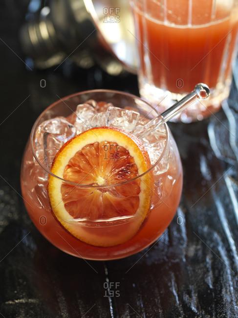 Blood orange cocktail served with cocktail shaker