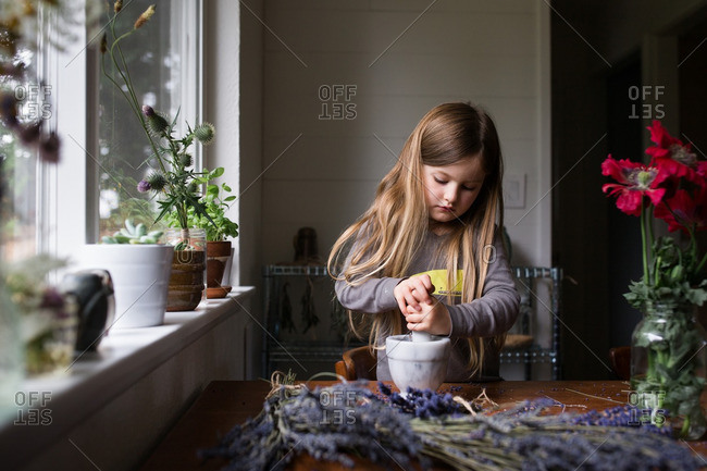 Girl using a mortar and pestle