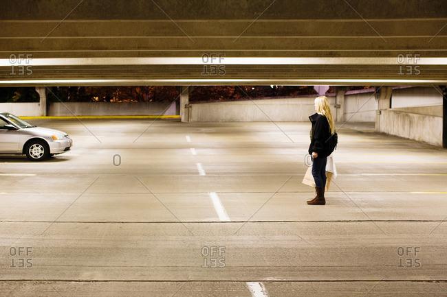 Woman in alone in parking lot