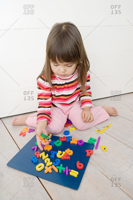 Girl playing with magnets