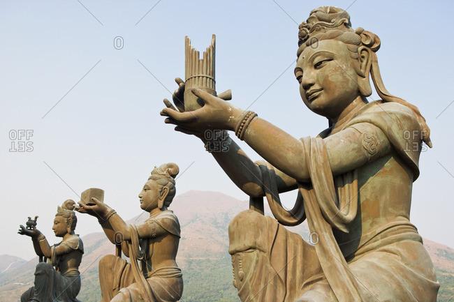 Statues near titan tan Buddha