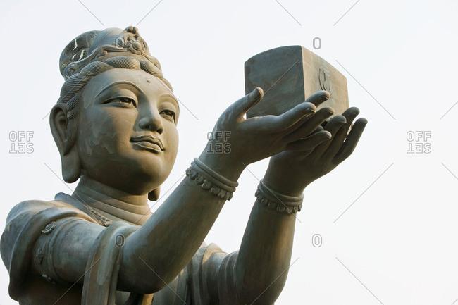 Statue near titan tan Buddha