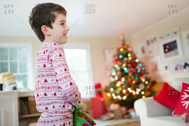 Boy opening his stocking on Christmas morning