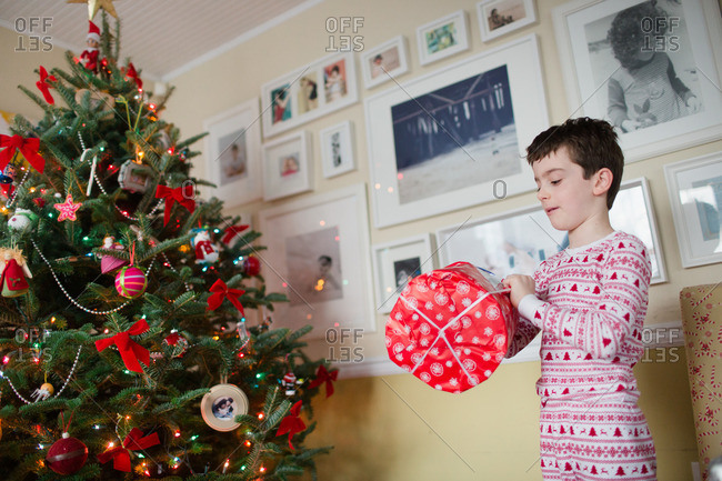 Boy opening a gift on Christmas morning