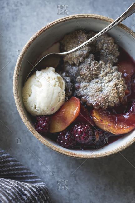 Blackberry peach buckwheat pandowdy and toasted buckwheat ice cream up close