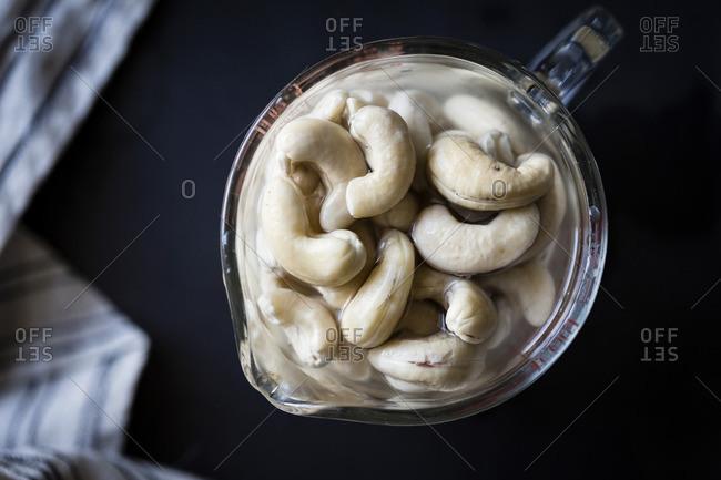 Cashew nuts soaking in a measuring jug