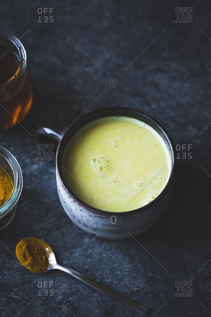 Golden Milk in a cup - mixed honey, turmeric, ginger, cardamom, and cinnamon