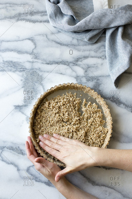 A gluten free tart crust, made from sliced almonds, shredded coconut, salt and maple syrup