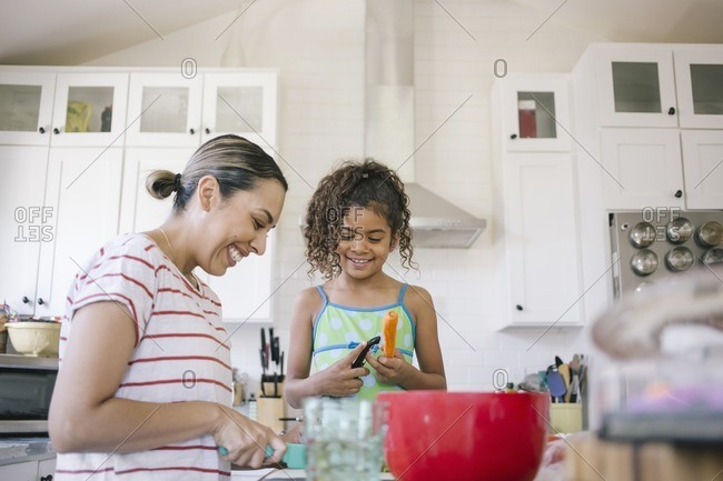 Mother and daughter preparing a meal together in the kitchen