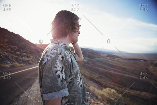 Young man looking off into the distance at scenic viewpoint in Death Valley, California