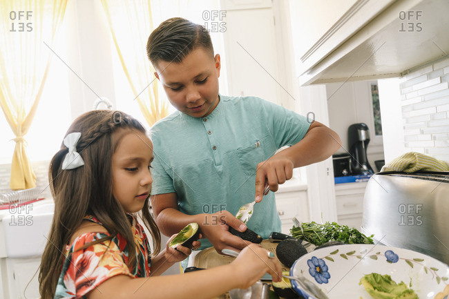 Children preparing guacamole