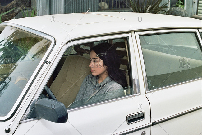 May 18, 2011: Young woman sitting in older white car