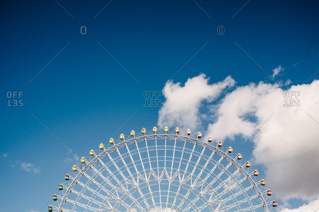 Large Ferris wheel against cloudy sky