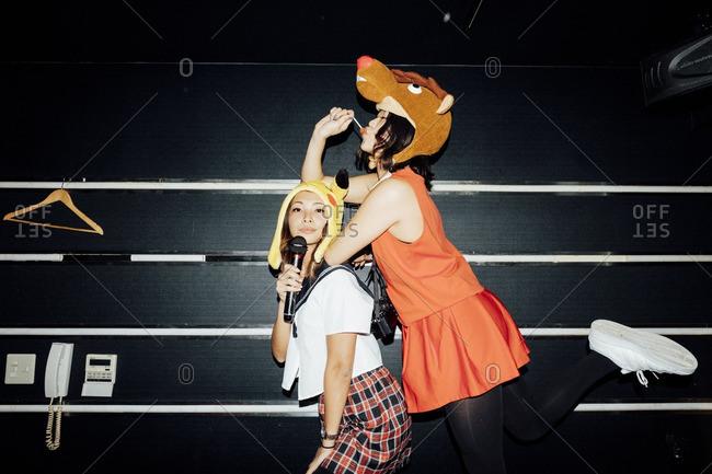 January 31, 2016: Two teen girls wearing goofy hats