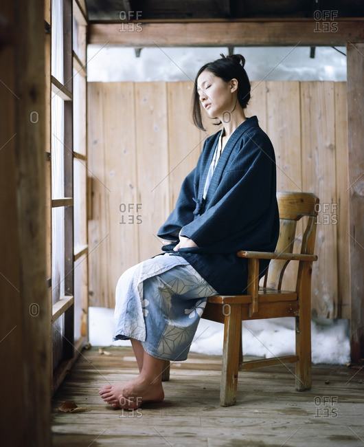 January 14, 2015: Asian woman sitting on a wooden chair