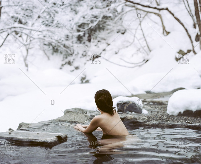 Woman in a river during winter