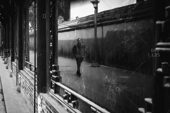 February 20, 2016: Man reflected in window while strolling