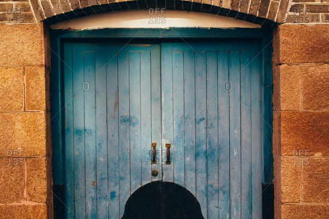 A door in stone block wall