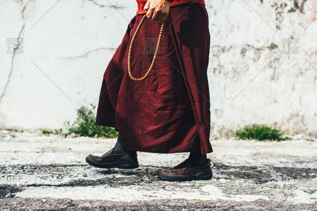 Person walking with prayer beads