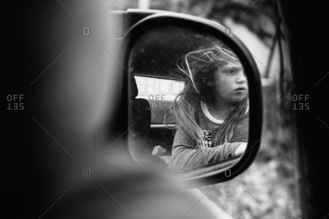 April 9, 2016: Girl reflected in car's mirror