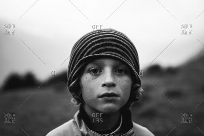 June 30, 2016: Boy in beanie standing outside