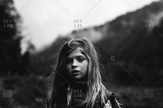 April 10, 2016: Girl in vest in rural setting