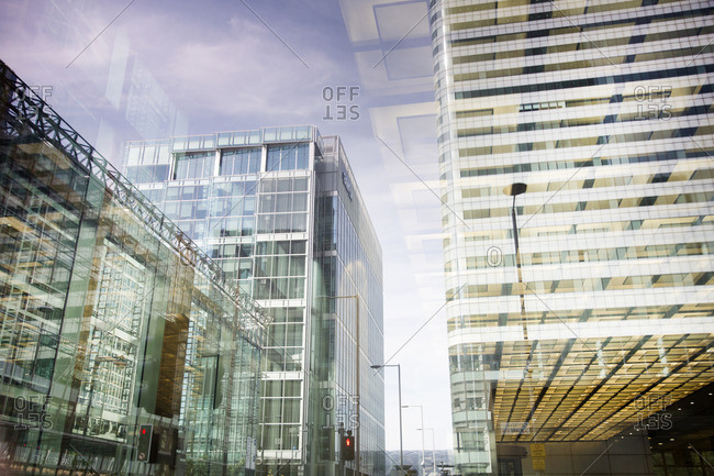 Reflection of office towers in glass in the Canary Wharf business district, London