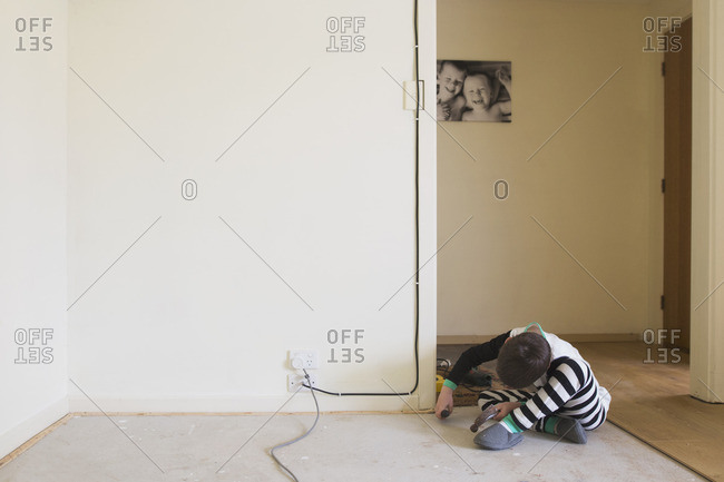 Boy helping with home improvement