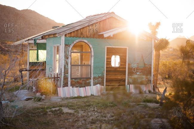 Abandoned blue shack in Californian desert