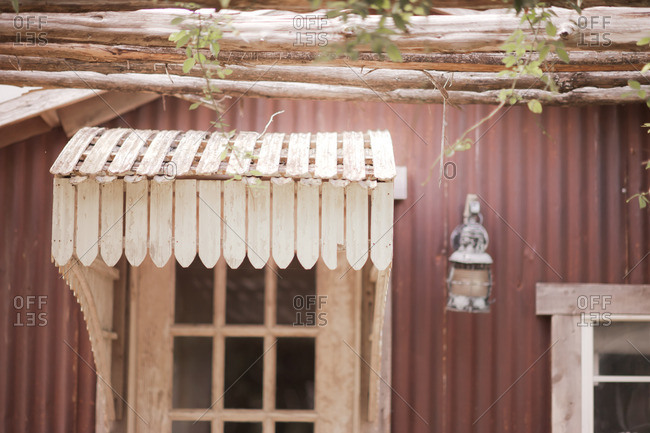Wooden awning on a red house
