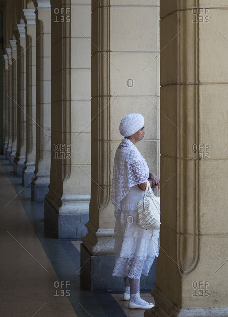 August 27, 2016: Woman waiting in colonnade