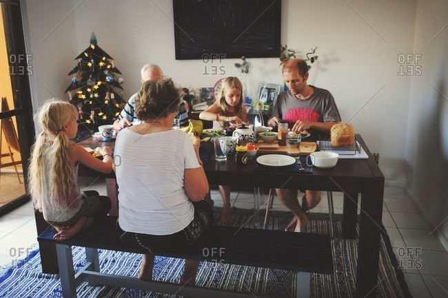 Family eating Christmas dinner together