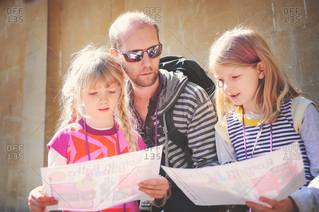 Girls and dad reading tourist information