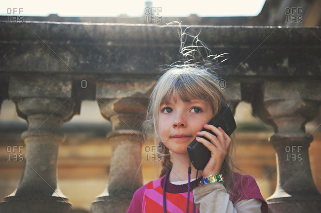A child listens to an audio guide