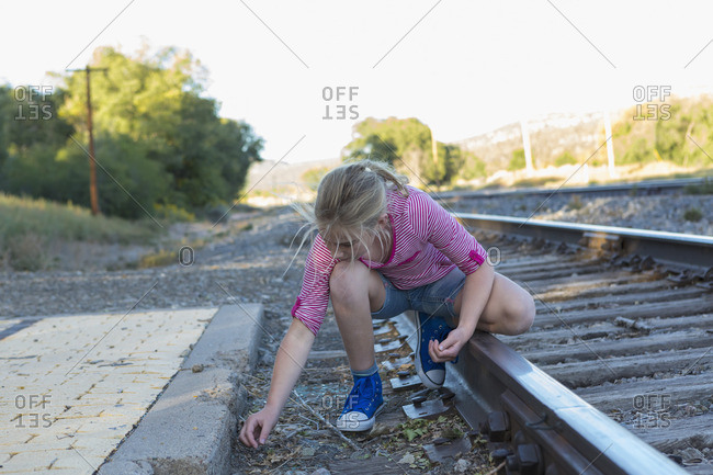 Girl exploring by train tracks