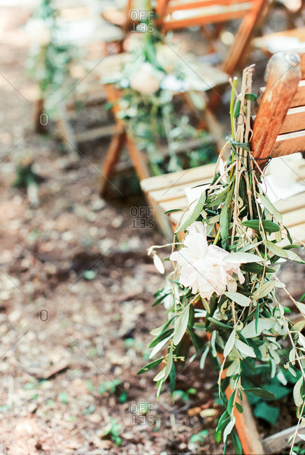 Flowers tied to folding chair