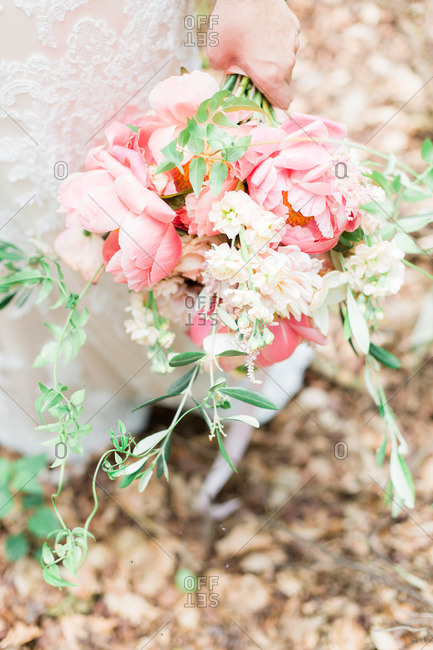 Bride holding pink flowers