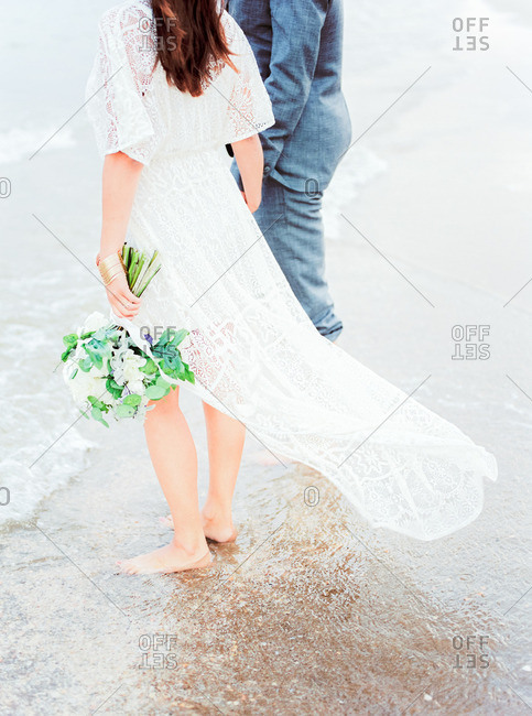 Bride and groom together on beach