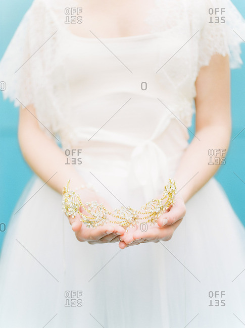 Bride holding a tiara in hands