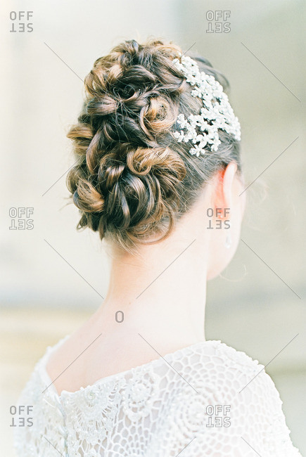 Bride with curls and hair accessory