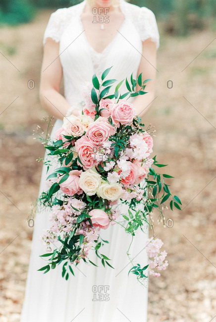 Bride holding ornate bouquet