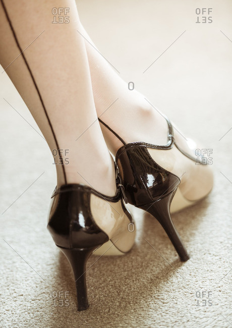 Woman wearing high heels and seamed stockings