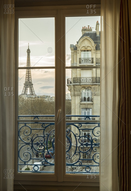 The Eiffel Tower visible through an apartment window in Paris, France