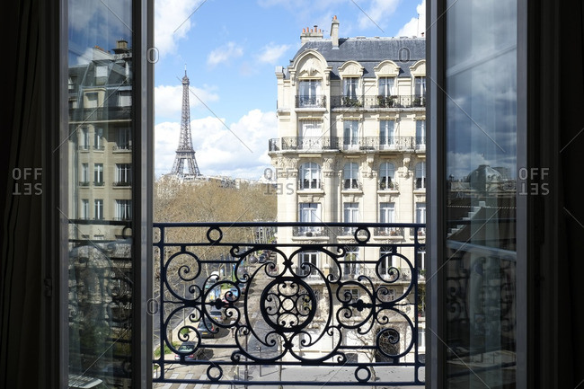 Eiffel Tower visible from an open window in Paris, France