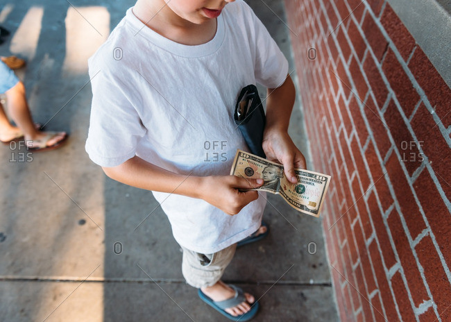 Young boy with a ten dollar bill