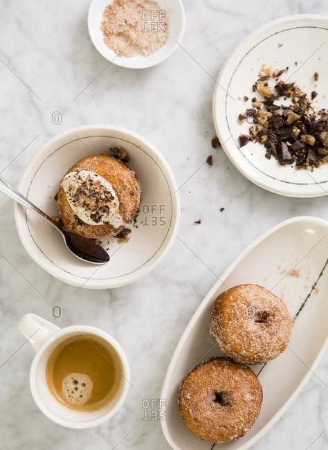 Coffee and donuts with a scoop of ice cream with crumbled chocolate brittle